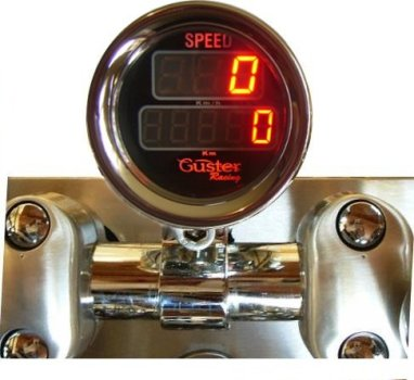 Velocimetro digital para motos e triciclos com odometro total e parcial de 52mm modelo VO - 50 montado em copo de aluminio cromado e sensor de velocidade. Resistente a água.